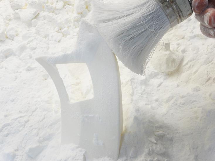 Nettoyage d'une pièce en frittage de poudre.